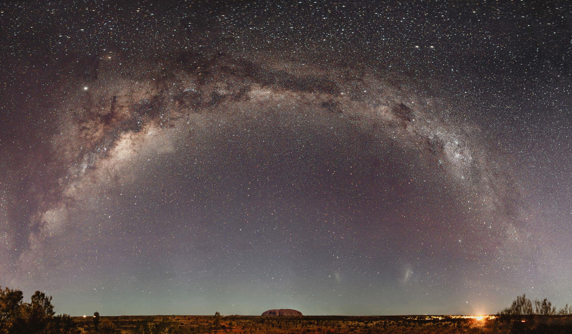 Uluru under the milky way of stars