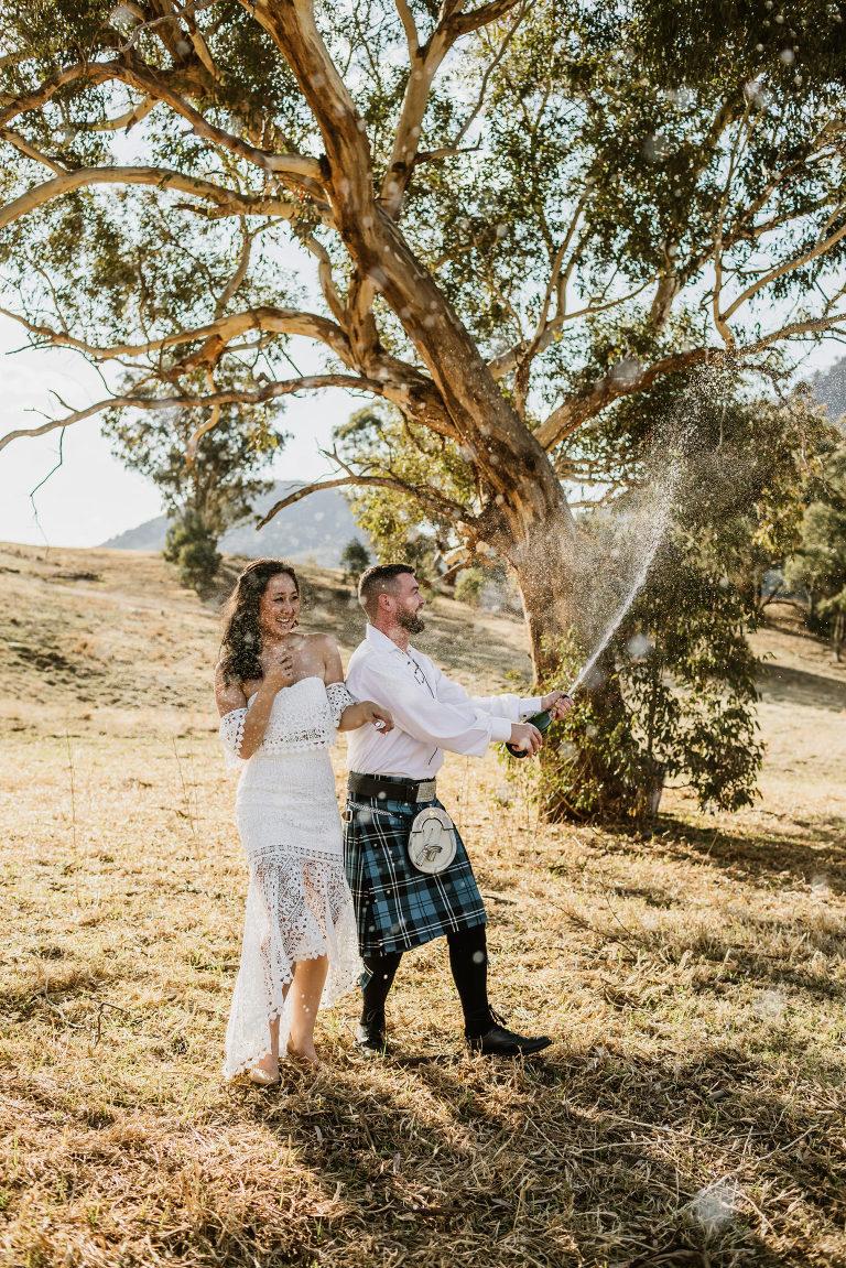 champagne spray at wolgan valley wedding